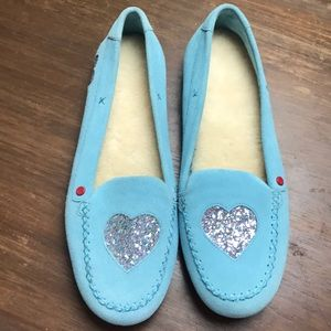 Beautiful blue UGG moccasins with glitter hearts